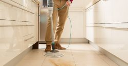 Man steam cleaning hard-floor with food mess